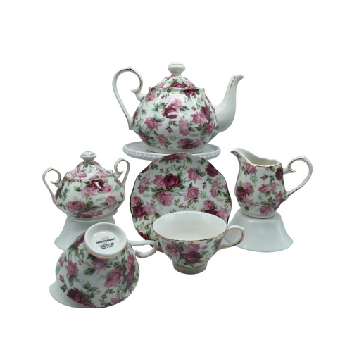 Grace Teaware Summer Rose Chintz Bouquet Tea Set Gift Boxed 11pc porcelain Grace Tea set in a Rose chintz with white background with gold trim. Beautiful and easy to incorporate into any table decor. Complete service for 4. Teapot holds 5 cups. Matching cream and sugar bowl. To be enjoyed for years to come.  Gifting Idea: birthday, bridal shower, or Mother's Day. treat yourself or someone you love!  Includes:  11 pc porcelain tea set by Grace Teaware 1- 5 cup Teapot 4 - cup/saucer set 1 - Cream/sugar set White background with rose chintz print on white background, gold trim. Dishwasher safe  Enclosure card included.