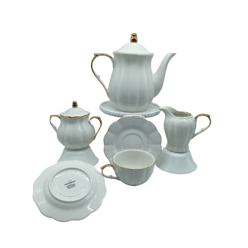 Grace Teaware White & Gold Scallop 11 pc Tea Set: 11pc porcelain Tea set in white with gold trim, scallop design. A classic, elegant set for 4. Very impressive on the table. What we love most about this classic beauty is that it can be used for any occassion, or holiday. This set includes 4 cups and saucers, cream and sugar bowl, 5 cup Teapot. Lovely for a ladies luncheon.  Gifting Idea: Birthday, Bridal Shower, or Mother's Day. treat yourself or someone you love!  Includes:  11 pc porcelain tea set by Grace Teaware 1- 5 cup Teapot 4 - cup/saucer set 1- cream/sugar set White background with gold trim. Dishwasher safe
