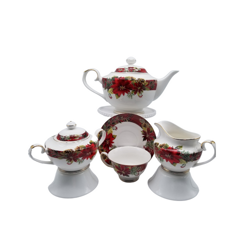 Red Poinsettia 11 pc - Tea Set: a beautiful Christmas poinsettia print tea set made of porcelain. 1 Teapot, 1 Set of Sugar & Creamer, and 4 Sets of Cup & Saucer. Gold Trimmed.  Add one of Cornucopia's Loose Leaf Christmas Tea blends to finnish off this special holiday gift.  Includes:  1 Teapot, 1 Set of Sugar & Creamer, and 4 Sets of Cup & Saucer. Gold Trimmed. Made of Porcelain. Dishwasher safe  Choose a Christmas Tea by the Cornucopia Shop  These specialty loose leaf teas are Christmas holiday blends that are seasonal favorties in herbals and black tea base with christmas spice blends, marshmallow, pear, organge and chocolate. Robust flavors, chuncky fruites and chocolate pieces to endulge and enjoy this holiday season.  Teas and Teaware are shipped together, Cornucopia Teas come in resealable pouches with decorative tea labels, and includes a recipe and brewing guide. If purchasing as a gift your personal message is included on the pamphlet.  Enclosed Gift Card Sample - Standard Cover and coupon with your personalized gift message. 200 characters max.