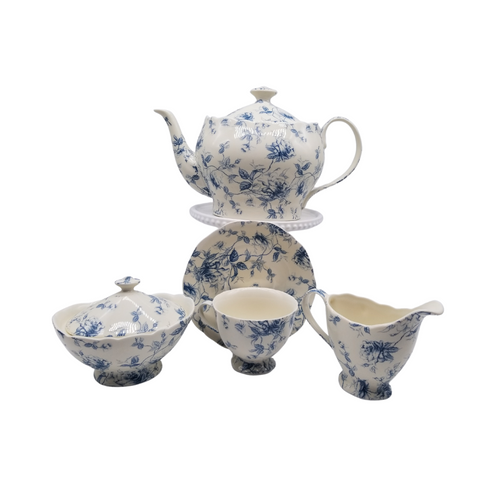Blue Toile 11 pc Tea Set: 11pc fine porcelain Tea set in blue toile print. 1 Teapot, 1 Set of Sugar & Creamer, and 4 Sets of Cup & Saucer. Inglaze Decal. Made of Porcelain. Lovely for a ladies luncheon.  Gifting Idea: Birthday, Bridal Shower, or Mother's Day. treat yourself or someone you love!  Includes:  11 pc porcelain tea set 1- 5 cup Teapot 4 - cup/saucer set 1- cream/sugar set Dishwasher safe   Complimentary Enclosure Card