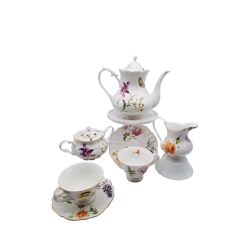 Dahlia Porcelain 11 pc Tea Set: 11pc porcelain Tea set in butterfly and floral print. 1 Teapot, 1 Set of Sugar & Creamer, and 4 Sets of Cup & Saucer. A little sunshine for your luncheon or breakfast table. Lovely for a ladies luncheon.  Gifting Idea: Birthday, Bridal Shower, or Mother's Day. treat yourself or someone you love!  Includes:  11 pc porcelain tea set 1- 5 cup Teapot 4 - cup/saucer set 1- cream/sugar set Dishwasher safe  Complimentary Enclosure Card