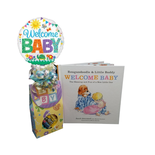 """New Sibling - Book Gift Set: Candy box with Welcome balloon bouquet. A baby book for a new sibling, big brother, or sister related story for children. Little ones adjusting to being big brothers and sisters for the first time will be able to experience all that comes with having a new baby at home through the eyes of a dog and his toddler best friend, making the transition of having a new sibling even smoother. Let this cheerful trio warm their heart and bring a smile to their day!  Reagandoodle and little buddy welcome baby siblings book. Baby candy box with Welcome air filled mylar balloon. Includes heavy paperboard candy box filled with a mix of name brand candy such as Starburst, SweetTarts, Tootsie Roll, Jolly Rancher, Skittles, Nerds, LaffyTaffy or Tootsie Fruit Chews. Mix may vary in each gift, Welcome Baby 9"""" air-filled balloon, ribbon curls, and your personal message on a gift card.  Complimentary enclosure card, tucked inside with your message. This gift comes in a cello bag with hand tied bow and is accompanied with the balloon bouquet."""