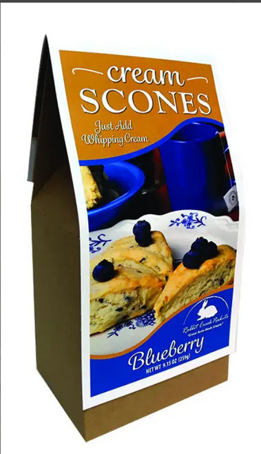 A Blueberry Cream Scone packed full of blueberries. These scones are quick and easy to make just add heavy whipping cream, mix, and bake...then ENJOY!!