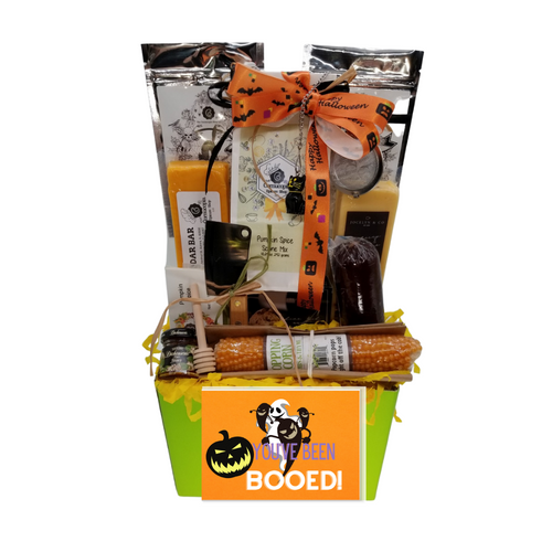 """You've Been Ghoul 'd- Gourmet Treats Gift Basket: From Cornucopia's Epicure Shop, a showcase of gourmet specialties brimming in fall flavors with pumpkin scone mix, popping corn cob, shelf-stable, cheeses, Summer Sausage, Gourmet Crackers, (by Jocelyn & Co) & (The Cornucopia Shop) Teas, all tucked inside this festive Halloween gift box.   Gift Includes:  Green Gift Basket Box, with Front Greeting Card Stainless Steel Cleaver, Cornucopia's Pumpkin Spice Scone Mix makes 8 scones, 3-Cornucopia brand Specialty Halloween Teas: 1 oz Black Cat Fruit tea blend, flavored Chocolate/Peanut/Caramel. Sweet chocolate aromas, combined with delicately melting caramel and the taste of crunchy peanuts will put a smile on any sweet tooth! 1 oz Black Witch's Brew, a mild China-Ceylon black tea blend, will remind you just how Witchfully delightful it can be with light-yellow orange peel and orange-red blazing safflower. 1 oz Black Rose Tea combines our full-bodied organic black tea with fragrant rose petals. 2"""" Halloween Black Cat Tea ball stainless steel Tea filter by Cha Cult (Germany) 1 oz Cornucopia's Pumpkin Spice Infused Sugar, .9 oz Olive Oil and Sea Salt Cracker Popping Corn Cob, *5 oz Hardwood Smoked Summer Sausage, *8 oz Cheddar Cheese bar 7"""" tall x ¾ """"thick, *8 oz Jalapeno Monterey Jack Cheese bar 7"""" tall x ¾ """"thick,  Dickinson's Mini Honey 1 oz, Honey Spool wooden.  *Gourmet Food products are made in the USA and are shelf stable.  Gift comes wrapped in cellophane with hand tied bow, a complimentary enclosure card with your personal message"""