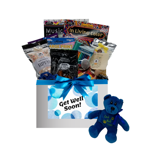 """You are Missed - Get Well Soon Care Basket: This healing wish care basket is filled with thoughtful items that provide, a message that it's okay to take it easy and heal. It's filled with healthy treats, a little fun, and lots of loving thoughts. A get well soon plush bear, healthy tea, mini honey, and tea ball to help keep them hydrated, chicken soup base mix. And when they're feeling better, adult coloring books and colored pencils, crossword and word find puzzle book, and a little sweet option with Raspberry or shortbread cookies to have with their tea.  Plush Get Well Bear, 2 Adult Coloring Books, Colored Pencil Set, Crossword and Word Find Puzzle Books, 1 oz 12 cups Cornucopia's Detox Tea (Loose Leaf) Ingredients: Organic lemongrass leaf, organic echinacea purpurea herb, organic licorice root, organic dandelion root, organic peppermint leaf, organic Tulsi leaf and organic ginger root. 1 1/2"""" Tea Ball, stainless steel, Dickinson's Mini Honey 1 oz, Honey Spool wooden, Chicken Noodle Soup Base, by Rabbit Creek for the Cornucopia Shop, East Shore Dipping Pretzel, 4 oz Walker's Fingers Shortbread Cookie -2 pack, 5 oz J & M Raspberry Tea Cookies.  Gift comes wrapped in cellophane with hand tied bow, a complimentary enclosure card with your personal get well message"""