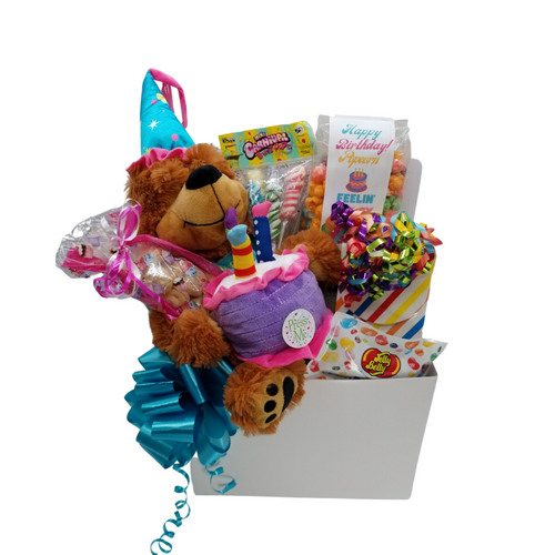 """Happy Birthday Musical Greetings  Musical happy birthday bear. Cake plays """"Happy Birthday to You!"""" 15"""" Measured sitting. Carnival Twist Pops 4 oz Happy Birthday Fruity Popcorn 1 oz Jelly Belly 20 Flavor Snack Bag Assorted flavors Assorted Birthday Candy Box, a mix of name brand candy such as Starburst, SweetTarts, Tootsie Roll, Jolly Rancher Skittles, Nerds, LaffyTaffy or Tootsie Fruit Chews. Mix may vary in each gift. ribbon curls, cellophane, and card.  Gift comes wrapped in cellophane with hand tied bow, a complimentary enclosure card with your personal message"""