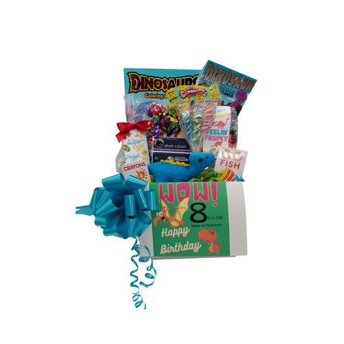 """Happy Birthday Dinosaur Fun: So much fun packed into this Happy Birthday gift box Dinosaur themed activities and treats to learn and enjoy on their birthday. Great for ages 3 and up. Comes with a stuffed dinosaur animal, coloring books, activity gifts, crayons, kids playing card go fish, Jelly Belly assorted jellybeans, Dino-Corn a tutti fruity popcorn, carnival twist pops, Dino-eggs a candy-coated pretzel bites, Birthday Box of hard candies name brand mix such as Starburst, SweetTarts, Skittles and much more. Personalized options, fill out here, before placing in the cart.  Includes:  Stuffed Dinosaur, (assorted dinosaur and colors), Dinosaur Coloring & Activity Book, 6 pc Crayon set, Dinosaur Activity Book, Dinosaur Fossil Building Set, (assorted sets) 15"""" Measured sitting. Go Fish playing card game, 2 oz bag Dino -Eggs – Candy Coated Pretzel Bites, Carnival assorted Twist Pops, 6 oz Dino Corn-Happy Birthday Fruity Popcorn, 1 oz Jelly Belly 20 Flavor Snack Bag, 4 oz Assorted Birthday Candy Box, a mix of name brand candy such as Starburst, SweetTarts, Tootsie Roll, Jolly Rancher Skittles, Nerds, LaffyTaffy or Tootsie Fruit Chews. Mix may vary in each gift. ribbon curls, Happy Birthday Dino greeting card: Personalized Child's Name Child's Age Your personal message on the flip side, tucked into the front of the gift box as shown.   Gift comes wrapped in cellophane with decorative bow"""
