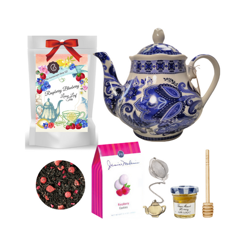"""Blue Paisley Teapot with Tea Gift: This lovely Tea and Teapot gift set with mini honey, honey spool, and teapot teaball sends happy greetings just in time for tea!  16 oz. by Kent pottery Teapot, with a classic blue paisley print on white background. Dishwasher and microwave safe. 1 oz of Cornucopia Shop's Organic Loose Leaf 8T21202 Raspberry/Blueberry Blk Tea (Loose Leaf): Fields full of organically grown berries as far as the eye can see – and in the middle there is us, gathering the best berries in a basket.  Ingredients: black tea (94%), natural flavoring, from organic cultivation: freeze-dried strawberry pieces, freeze-dried raspberry pieces, freeze-dried red currants,  Taste: Refreshing red strawberries, black currants and bright pink raspberries kissed by the sun, are just waiting to be enjoyed. An additional touch of freshly picked blueberries rounds off our organic creation. Try it as an iced tea as well.  Mini Honey by Bonne Maman 1 oz Honey Spool, Wooden Teaball by Cha Cult, with teapot charm chain, stainless steel 2"""" ball 2.5 oz. - J&M Tea Cookies - Raspberry   Gift comes in a gift basket tray shrink wrapped with hand made bow. Enclosure card with 10% off coupon on purchase of tea, and your personal gift message."""