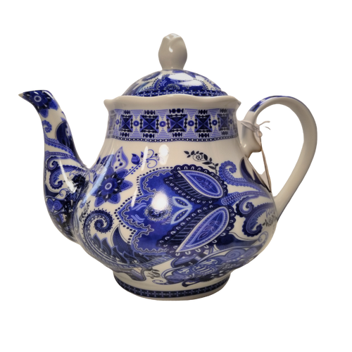 The Blue Paisley Teapot: White 16 oz. Kent pottery teapot with a classic blue paisley print. Dishwasher and microwave safe. Enjoy Cornucopia's Organic Loose Leaf Tea in this bright and cheery teapot.  Give as a gift or splurge on yourself.