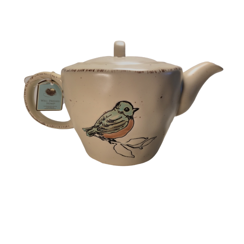 Earthen Bird Teapot with Optional Tea Gift: Glazed Earthenware 32 oz Bird on both sides brown accents on beige background. Dishwasher and microwave safe Dishwasher and microwave safe.  Enjoy 2 oz. of Cornucopia Shop's Organic Loose Leaf Tea in this bright and cheery teapot.  Tea choices available with order. Ships together in decorative tea packaging.