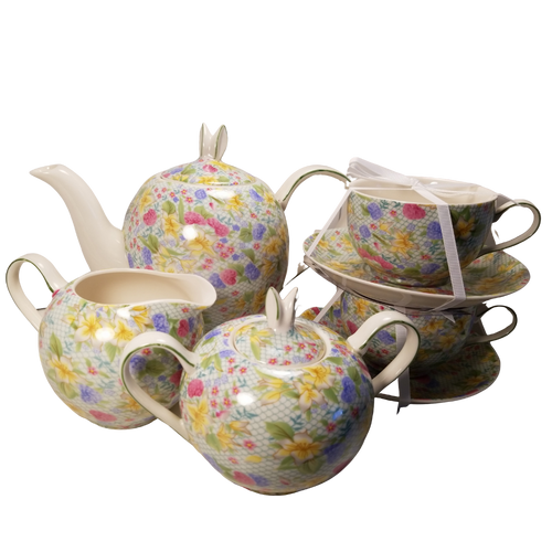 Bunny Spring Tea Set with Optional Tea Gift: This delightful porcelain spring floral print tea set is topped with delicate bunny ear handles on the teapot and sugar bowl.  Set contains: 4 cup teapot, 2 matching cups and saucers, matching creamer and sugar bowl.  Will bring a little cheer to your everyday table.    Porcelain Dishwasher and microwave safe.  Enjoy 2 oz. of Cornucopia Shop's Organic Loose Leaf Tea in this bright and cheery teapot.  Tea choices available with orders, decorative tea packaging. Ships together.