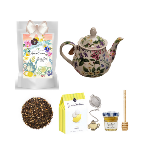 "Botanical Teapot with Tea Gift:  This lovely Tea and Teapot gift set with mini honey, honey spool, and teapot teaball sends happy greetings just in time for tea!   16 oz. by Kent pottery. white with botanical floral print in shades of green, white, pink and yellow. Dishwasher and microwave safe. 1 oz of Cornucopia Shop's Organic Loose Leaf 7T6345 Lemon Essence with Peel (Loose Leaf) combines organic green rooibos and black tea with citrus. Ingredients: Organic green rooibos, organic black tea, organic lemon peel and organic lemon myrtle. Taste: a full-bodied black tea brew with a splash of citrus zest and a subtle sweetness, provided by the green rooibos. Mini Honey by Bonne Maman 1 oz Honey Spool, Wooden  Teaball by Cha Cult, with teapot charm chain, stainless steel  2"" ball  2.5 oz. - J&M Tea Cookies - Lemon    Gift comes in a gift basket tray shrink wrapped with hand made bow.  Enclosure card with 10% off coupon on purchase of tea, and your personal gift message."