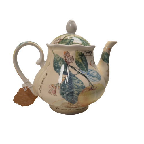 Butterfly Garden Teapot: 16 oz. by Kent pottery. White with a whimsical Butterfly and floral print in soft shades of green, yellow, and white. Dishwasher and microwave safe.  Enjoy 2 oz. of Cornucopia Shop's Organic Loose Leaf Tea in this bright and cheery teapot.  Tea choices available with order,  Ships together in decorative tea packaging.
