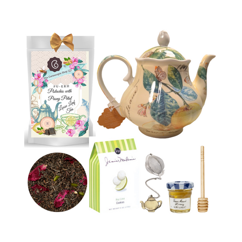 """Butterfly Garden Teapot with Tea Gift: This lovely Tea and Teapot gift set with mini honey, honey spool, and teapot teaball sends happy greetings just in time for tea!  16 oz. by Kent pottery Teapot, white with a whimsical Butterfly and floral print in soft shades of green, yellow, and white.Dishwasher and microwave safe. 1 oz of Cornucopia Shop's Organic Loose Leaf 8T21093 Pu-Erh-Pistachio Peony Petal (Loose Leaf): This strongly spicy and earthy tea blend has found a perfect partner in the wonderfully nutty pistachio. The optic is ennobled by shining peony petals and the crunchy pistachios put an oriental touch to this creation.  Ingredients: black tea Pu Erh (93%), pistachios, flavoring, peony petals  Taste: Earthy rich flavor with hint of pistachios and a light floral lift of peony petals will awaken your senses and renew your taste buds with this exquisite tea.  Mini Honey by Bonne Maman 1 oz Honey Spool, Wooden Teaball by Cha Cult, with teapot charm chain, stainless steel 2"""" ball 2.5 oz. - J&M Tea Cookies - Key Lime    Gift comes in a gift basket tray shrink wrapped with hand made bow. Enclosure card with 10% off coupon on purchase of tea, and your personal gift message."""