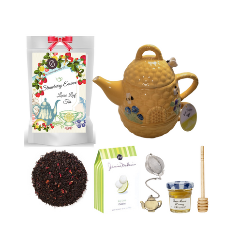 """Beehive Nested Teapot with Tea Gift: Fill the teapot with your favorite tea and nest it in the serving teacup while it brews. comes with cookies, honey and tea accessories for an instant personal pamper session. Ideal for those times when it's just you and two cups are a must  1 - Stacked Teacup and Teapot by Be Happy. Handwash, do not microwave. 1 oz of Cornucopia Shop's Organic Tea 7T6394 Strawberry Essence (Loose Leaf) combines organic black tea with a splash of sweet strawberry nuance. Ingredients: Organic black tea, organic hibiscus, natural flavor and organic rose petals. Taste: A full-bodied black tea brew with a fruity finish. Mini Honey by Bonne Maman 1 oz Honey Spool, Wooden Teaball by Cha Cult, with teapot charm chain, stainless steel 2"""" ball 2.5 oz. - J&M Tea Cookies - Key Lime    Gift comes in a gift basket tray shrink wrapped with hand made bow. Enclosure card with 10% off coupon on purchase of tea, and your personal gift message."""