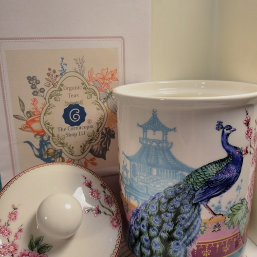 Peacock Tea Canister: Porcelain Tea Canister with optional 8 oz. Organic Loose Leaf Tea by The Cornucopia Tea Shop  This beautiful porcelain Peacock print will bring an extra touch of happiness to your tea time.  Lid is air tight to keep your Tea fresh for it's full shelf life.  Care: Dishwasher safe  Optional: Choose one of Cornucopia's Organic loose leaf teas ( 8 oz. 1/2 LB)Tea card with description and brewing instructions enclosed. Comes shipped together.