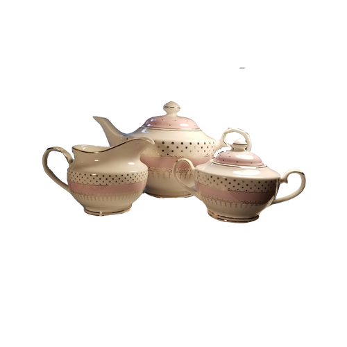 Pink Polka Dot Teapot 3 PC  set: Bright and cheery for everyday use with matching cream and sugar bowl.  Lovely to add to your collection and include in your tea time gatherings.   Includes:  16 oz. teapot sugar bowl and creamer White with a pastel pink polka dot print with gold trim on handles and lids and base Handwash Tea choices available to add to your order in the loose leaf shop  ships together in decorative tea packaging.