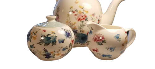 Spring Meadow Teapot Set: 3 PC set. Bright and cherry for everyday use with matching cream and sugar bowl. Lovely to add to your collection and include in your tea time gatherings.  Includes:  16 oz. teapot, sugar bowl and creamer Soft white with a pastel floral print Handwash Tea choices available to add to your order in the loose leaf shop ships together in decorative tea packaging.