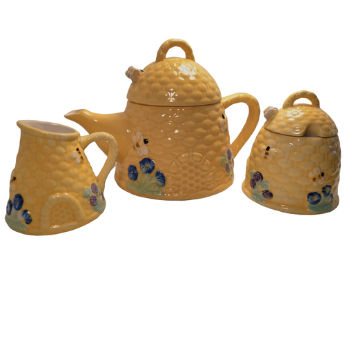 Beehive Teapot 3 PC set: Charming beehive pattern with bizzy bees. matching cream and sugar bowl. Includes:  8 oz. teapot, sugar bowl and creamer Bright yellow beehive pattern with bizzy bees on lids and sides of pot. Handwash Tea choices available to add to your order in the loose leaf shop ships together in decorative tea packaging.