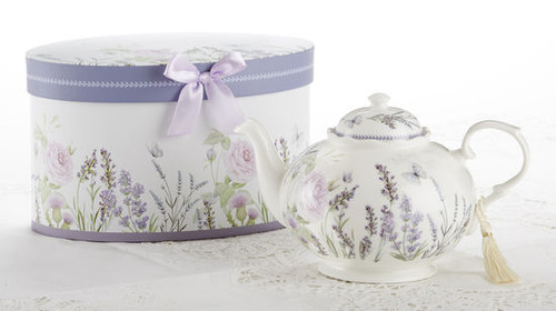 """Lavender Fields Teapot in gift box, will brighten anyone's day with this beautiful teapot gift in its own lavender flower print gift box with matching satin ribbon. A decorative tassel on the handle adds a lovely finishing touch. Gifting Idea: birthday gift, bridal shower, get well, treat yourself or someone you love.  Includes:  9.5 x 5.6"""" Porcelain teapot Soft white background with lavender floral print Dishwasher safe  Other Items Available:  Matching cup and saucer available D8101-7  Tea choices available to add to your order in the loose-leaf shop  Teas and Teaware are shipped together, Cornucopia Teas come in resealable pouches with decorative tea labels, and includes a recipe and brewing guide. If purchasing as a gift your personal message is included on the pamphlet."""