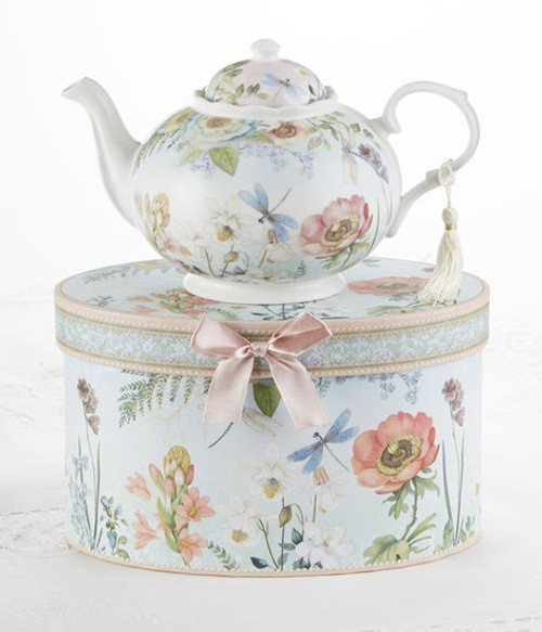 "Dragonfly Teapot in gift box, will brighten anyone's day with this beautiful teapot gift in its own matching print gift box with matching satin ribbon. A decorative tassel on the handle adds a lovely finishing touch. Gifting Idea: birthday gift, bridal shower, get well, treat yourself or someone you love.   Includes:  9.5 x 5.6"" teapot Soft white background with a Dragonfly and floral print Dishwasher safe  Other Items Available:  Matching cup and saucer available D8135-0  Tea choices available to add to your order in the loose-leaf shop   Teas and Teaware are shipped together, Cornucopia Teas come in resealable pouches with decorative tea labels, and includes a recipe and brewing guide. If purchasing as a gift your personal message is included on the pamphlet."