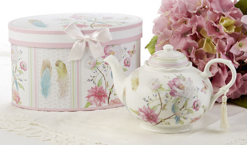 """Feather and Floral Teapot 32 oz in gift box, will brighten anyone's day with this beautiful Teapot gift in its own matching print gift box and matching satin ribbon. A decorative tassel on the handle adds a lovely finishing touch. Gifting Ideas: birthday gift, bridal shower, get well, treat yourself or someone you love.  Includes: • 9.5 x 5.6"""" Porcelain teapot • Soft white background with a feather and floral print in bright cheery pastels, Dishwasher safe  •Matching cup and saucer available D8135-6 •Tea choices available to add to your order in the loose-leaf shop   Teas and Teaware are shipped together, Cornucopia Teas come in resealable pouches with decorative tea labels, and includes a recipe and brewing guide. If purchasing as a gift your personal message is included on the pamphlet."""