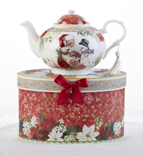 """Santa Teapot in gift box, a beautiful Christmas teapot gift in its own matching print gift box with coordinating satin ribbon. A decorative tassel on the handle adds a lovely finishing touch. To be enjoyed throughout the holiday season, makes a lovely gift for that special Tea drinker on your gift list! Add one of Cornucopia's Loose Leaf Christmas Tea blends to finnish off this special holiday gift.  Includes:  9.5 x 5.6"""" teapot Soft white with a Christmas floral print background with Santa and his friends Dishwasher safe  Choose a Christmas Tea by the Cornucopia Shop  These specialty loose leaf teas are Christmas holiday blends that are seasonal favorties in herbals and black tea base with christmas spice blends, marshmallow, pear, organge and chocolate. Robust flavors, chuncky fruites and chocolate pieces to endulge and enjoy this holiday season.  Teas and Teaware are shipped together, Cornucopia Teas come in resealable pouches with decorative tea labels, and includes a recipe and brewing guide. If purchasing as a gift your personal message is included on the pamphlet."""