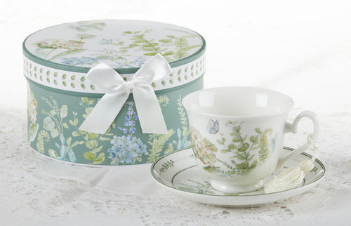 """Blue Hydrangea Cup/Saucer in gift box, will brighten anyone's day in its own matching print gift box with matching satin ribbon. A decorative tassel on the handle adds a lovely finishing touch. Gifting Idea: birthday gift, bridal shower, get well, treat yourself or someone you love.  Includes:  3.5"""" Cup/Saucer in gift box Soft white background with a Blue Hydrangea and pastel floral print Dishwasher safe  Other Items Available:  Matching Teapot available D8150-4  Tea choices available to add to your order in the loose-leaf shop  Teas and Teaware are shipped together, Cornucopia Teas come in resealable pouches with decorative tea labels, and includes a recipe and brewing guide. If purchasing as a gift your personal message is included on the pamphlet."""