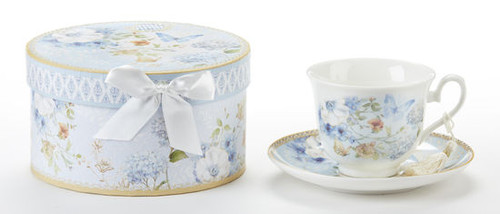 """Blue Butterfly Cup/Saucer in gift box, will brighten anyone's day in its own matching print gift box with matching satin ribbon. A decorative tassel on the handle adds a lovely finishing touch. Gifting Idea: birthday gift, bridal shower, get well, treat yourself or someone you love.  Includes:  3.5"""" Cup/Saucer in gift box Soft white background with a Blue Hydrangea and pastel floral print Dishwasher safe  Other Items Available:  Matching Teapot available D8141-2  Tea choices available to add to your order in the loose-leaf shop  Teas and Teaware are shipped together, Cornucopia Teas come in resealable pouches with decorative tea labels, and includes a recipe and brewing guide. If purchasing as a gift your personal message is included on the pamphlet."""