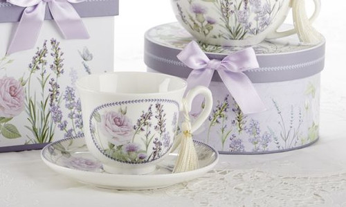 """Lavender Fields Cup/Saucer in gift box, will brighten anyone's day in its own matching print gift box with matching satin ribbon. A decorative tassel on the handle adds a lovely finishing touch. Gifting Idea: birthday gift, bridal shower, get well, treat yourself or someone you love.  Includes:  3.5"""" Cup/Saucer in gift box Soft white background with a Lavender floral print Dishwasher safe  Other Items Available:  Matching Teapot available D8100-7 Tea choices available to add to your order in the loose-leaf shop Teas and Teaware are shipped together, Cornucopia Teas come in resealable pouches with decorative tea labels, and includes a recipe and brewing guide. If purchasing as a gift your personal message is included on the pamphlet."""