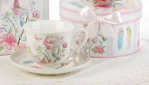 """Feather and Floral Cup/Saucer in gift box, will brighten anyone's day in its own matching print gift box with matching satin ribbon. A decorative tassel on the handle adds a lovely finishing touch. Gifting Idea: birthday gift, bridal shower, get well, treat yourself or someone you love.  Includes:  3.5"""" Cup/Saucer in gift box Soft white background with a Feather and Floral print Dishwasher safe  Other Items Available:  Matching Teapot available D8134-6 Tea choices available to add to your order in the loose-leaf shop Teas and Teaware are shipped together, Cornucopia Teas come in resealable pouches with decorative tea labels, and includes a recipe and brewing guide. If purchasing as a gift your personal message is included on the pamphlet."""