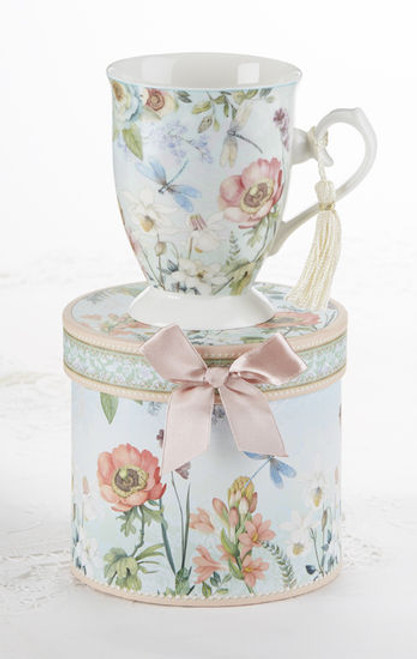 "Dragonfly Mug in gift box, will brighten anyone's day in its own matching print gift box with matching satin ribbon. A decorative tassel on the handle adds a lovely finishing touch. Gifting Idea: birthday gift, bridal shower, get well, treat yourself or someone you love.   Includes:  4.9"" Mug in gift box Soft white background with a Dragonfly floral print Dishwasher safe  Other Items Available:  Tea choices available to add to your order in the loose-leaf shop  Teas and Teaware are shipped together, Cornucopia Teas come in resealable pouches with decorative tea labels, and includes a recipe and brewing guide. If purchasing as a gift your personal message is included on the pamphlet."