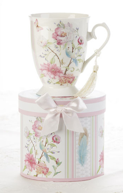 """Feather and Floral Mug in gift box, will brighten anyone's day in its own matching print gift box with matching satin ribbon. A decorative tassel on the handle adds a lovely finishing touch. Gifting Idea: birthday gift, bridal shower, get well, treat yourself or someone you love.  Includes:  4.9"""" Mug in gift box Soft white background with a Feather and Floral print Dishwasher safe  Other Items Available:  Tea choices available to add to your order in the loose-leaf shop Teas and Teaware are shipped together, Cornucopia Teas come in resealable pouches with decorative tea labels, and includes a recipe and brewing guide. If purchasing as a gift your personal message is included on the pamphlet."""