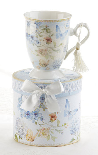 """Blue Butterfly Mug in gift box, will brighten anyone's day in its own matching print gift box with matching satin ribbon. A decorative tassel on the handle adds a lovely finishing touch. Gifting Idea: birthday gift, bridal shower, get well, treat yourself or someone you love.  Includes:  4.9"""" Mug in gift box Soft white background with a Blue Butterfly and Floral print Dishwasher safe  Other Items Available:  Tea choices available to add to your order in the loose-leaf shop Teas and Teaware are shipped together, Cornucopia Teas come in resealable pouches with decorative tea labels, and includes a recipe and brewing guide. If purchasing as a gift your personal message is included on the pamphlet."""