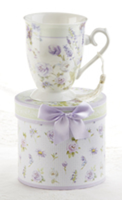 """Lavender Rose Mug in gift box, will brighten anyone's day in its own matching print gift box with matching satin ribbon. A decorative tassel on the handle adds a lovely finishing touch. Gifting Idea: birthday gift, bridal shower, get well, treat yourself or someone you love.  Includes:  4.9"""" Mug in gift box Soft white background with a Lavender Rose Floral print Dishwasher safe  Other Items Available:  Tea choices available to add to your order in the loose-leaf shop Teas and Teaware are shipped together, Cornucopia Teas come in resealable pouches with decorative tea labels, and includes a recipe and brewing guide. If purchasing as a gift your personal message is included on the pamphle"""