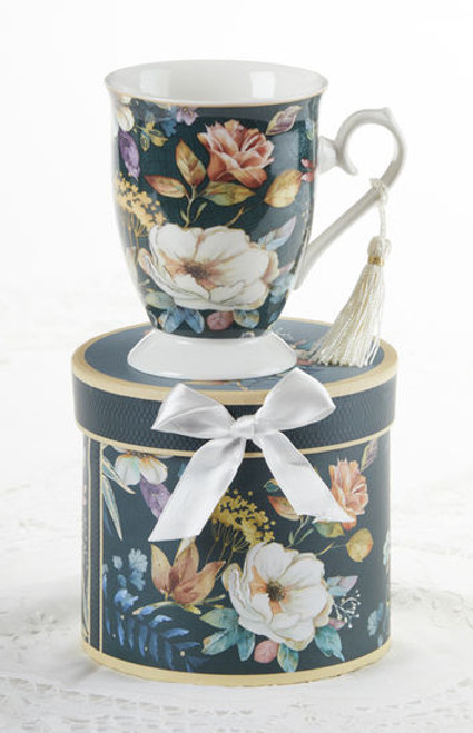 """English Camellia Mug in gift box, will brighten anyone's day in its own matching print gift box with matching satin ribbon. A decorative tassel on the handle adds a lovely finishing touch. Gifting Idea: birthday gift, bridal shower, get well, treat yourself or someone you love.  Includes:  4.9"""" Mug in gift box Soft white background with a floral print Dishwasher safe  Other Items Available:  Tea choices available to add to your order in the loose-leaf shop Teas and Teaware are shipped together, Cornucopia Teas come in resealable pouches with decorative tea labels, and includes a recipe and brewing guide. If purchasing as a gift your personal message is included on the pamphlet."""