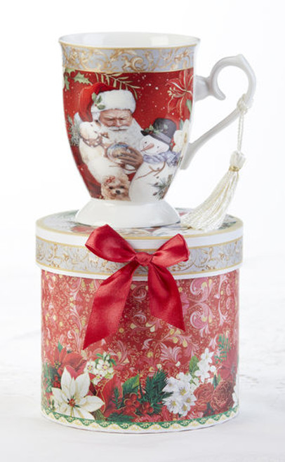 """Santa Mug in gift box, will brighten this holiday season in its own matching print gift box with matching satin ribbon. A decorative tassel on the handle adds a lovely finishing touch.  Includes:  4.9"""" Mug in gift box Soft white background with a floral Christmas print Dishwasher safe  Other Items Available:  Tea choices available to add to your order in the loose-leaf shop Teas and Teaware are shipped together, Cornucopia Teas come in resealable pouches with decorative tea labels, and includes a recipe and brewing guide. If purchasing as a gift your personal message is included on the pamphlet."""