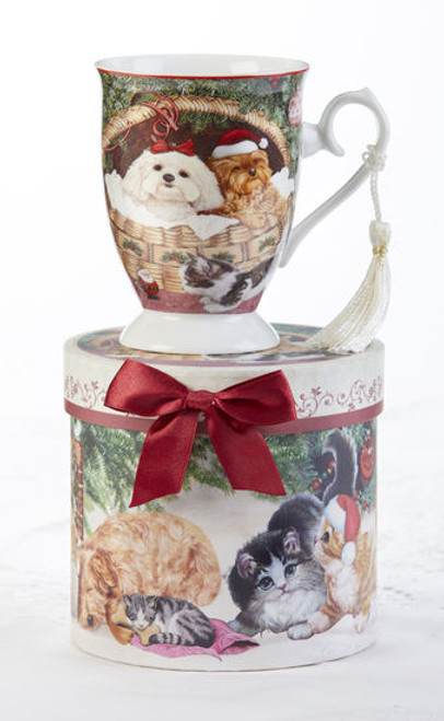 """Christmas Pets Mug in gift box, will brighten this holiday season in its own matching print gift box with matching satin ribbon. A decorative tassel on the handle adds a lovely finishing touch.  Includes:  4.9"""" Mug in gift box Christmas red background with a floral and Christmas pets print Dishwasher safe  Other Items Available:  Tea choices available to add to your order in the loose-leaf shop Teas and Teaware are shipped together, Cornucopia Teas come in resealable pouches with decorative tea labels, and inc"""