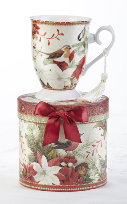 """Christmas Bird Mug in gift box, will brighten this holiday season in its own matching print gift box with matching satin ribbon. A decorative tassel on the handle adds a lovely finishing touch.  Includes:  4.9"""" Mug in gift box Christmas red background with a floral and Christmas bird print Dishwasher safe  Other Items Available:  Tea choices available to add to your order in the loose-leaf shop Teas and Teaware are shipped together, Cornucopia Teas come in resealable pouches with decorative tea labels, and includes a recipe and brewing guide. If purchasing as a gift your personal message is included on the pamphlet."""