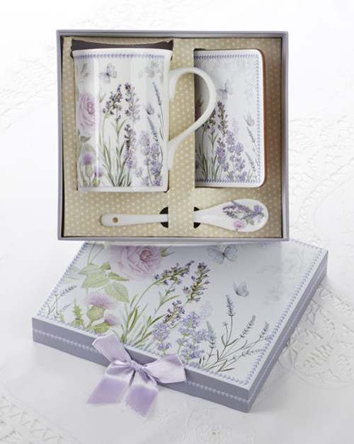"""Lavender Mug Coaster Spoon Set in gift box, will brighten anyone's day in its own matching print gift box with matching satin ribbon. A decorative tassel on the handle adds a lovely finishing touch. The matching coaster is perfect for any spot you leave your cup and the porcelian teaspoon makes tea time all the more special. Gifting Idea: birthday gift, bridal shower, get well, office gift, or thank you.  Includes:  4.9"""" Porcelain Mug in gift box Matching Coaster Matching Porcelian Teaspoon Soft white background with a lavender floral print Dishwasher safe  Other Items Available:  Tea choices available to add to your order in the loose-leaf shop Teas and Teaware are shipped together, Cornucopia Teas come in resealable pouches with decorative tea labels, and includes a recipe and brewing guide. If purchasing as a gift your personal message is included on the pamphlet."""