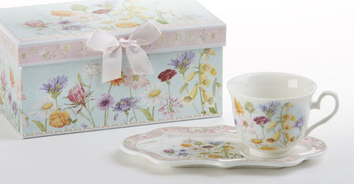 """Wildflower Tea and Toast Set in gift box: Enjoy your morning breakfast or afternoon tea and snack on this pretty set. A pleasant way to create a moment of indulgence. Add one of our specialty loose leaf teas and cuddle up with a good book, sounds invigting to whisk your cares away. Meant for everyday use. Comes in its own matching print gift box with matching satin ribbon. Great Gift Idea: New Mommy, Birthday, get well, thank you.  Includes:  4.2"""" x 9"""" tray Porcelain Teacup Soft white background with a floral print Dishwasher safe  Other Items Available:  Tea choices available to add to your order in the loose-leaf shop Teas and Teaware are shipped together, Cornucopia Teas come in resealable pouches with decorative tea labels, and includes a recipe and brewing guide. If purchasing as a gift your personal message is included on the pamphlet."""