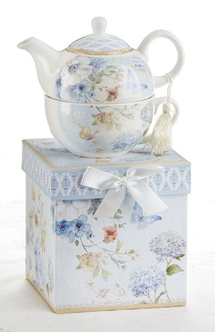"""Blue Butterfly Tea for one set in gift box, will brighten anyone's day with this beautiful tea for one gift set in its own matching print gift box with matching satin ribbon. A decorative tassel on the handle adds a lovely finishing touch. Gifting Idea: birthday gift, bridal shower, get well, thank you or treat yourself. Holds enough for a refill without leaving your comfy spot, desk or sip at beside for an evening nightcap.  Includes:  5.8"""" Tea for One Set in gift box Stacked teapot and ovesized teacup Soft white background with a Blue Butterfly and pastel floral print Dishwasher safe  Other Items Available:  Tea choices available to add to your order in the loose-leaf shop  Teas and Teaware are shipped together, Cornucopia Teas come in resealable pouches with decorative tea labels, and includes a recipe and brewing guide. If purchasing as a gift your personal message is included on the pamphlet."""