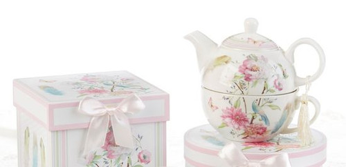 """Feather and Floral Tea for one set in gift box, will brighten anyone's day with this beautiful tea for one gift set in its own matching print gift box with matching satin ribbon. A decorative tassel on the handle adds a lovely finishing touch. Gifting Idea: birthday gift, bridal shower, get well, thank you or treat yourself. Holds enough for a refill without leaving your comfy spot, desk or sip at beside for an evening nightcap.  Includes:  5.8"""" Tea for One Set in gift box Stacked teapot and oversized teacup Soft white background with a feather and pastel floral print Dishwasher safe  Other Items Available:  Tea choices available to add to your order in the loose-leaf shop  Teas and Teaware are shipped together, Cornucopia Teas come in resealable pouches with decorative tea labels, and includes a recipe and brewing guide. If purchasing as a gift your personal message is included on the pamphlet."""
