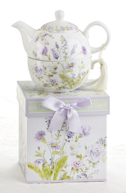 "Lavender Rose Tea for one set in gift box, will brighten anyone's day with this beautiful tea for one gift set in its own matching print gift box with matching satin ribbon. A decorative tassel on the handle adds a lovely finishing touch. Gifting Idea: birthday gift, bridal shower, get well, thank you or treat yourself. Holds enough for a refill without leaving your comfy spot, desk or sip at beside for an evening nightcap.   Includes:  5.8"" Tea for One Set in gift box Stacked teapot and oversized teacup Soft white background with a lavender and roses floral print Dishwasher safe  Other Items Available:  Tea choices available to add to your order in the loose-leaf shop   Teas and Teaware are shipped together, Cornucopia Teas come in resealable pouches with decorative tea labels, and includes a recipe and brewing guide. If purchasing as a gift your personal message is included on the pamphlet."