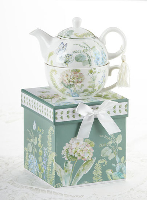 """Blue Hydrangea Tea for one set in gift box, will brighten anyone's day with this beautiful tea for one gift set in its own matching print gift box with matching satin ribbon. A decorative tassel on the handle adds a lovely finishing touch. Gifting Idea: birthday gift, bridal shower, get well, thank you or treat yourself. Holds enough for a refill without leaving your comfy spot, desk or sip at beside for an evening nightcap.  Includes:  5.8"""" Tea for One Set in gift box Stacked teapot and oversized teacup Soft white background with a blue Hydrangea floral print Dishwasher safe  Other Items Available:  Tea choices available to add to your order in the loose-leaf shop  Teas and Teaware are shipped together, Cornucopia Teas come in resealable pouches with decorative tea labels, and includes a recipe and brewing guide. If purchasing as a gift your personal message is included on the pamphlet."""