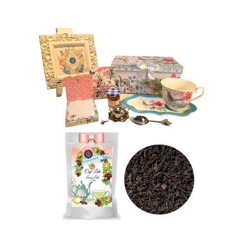 """Tea and Toast Gift Set - Partridge: Enjoy your morning breakfast or afternoon tea and snack on this pretty set. A pleasant way to create a moment of indulgence. Sip on Conrcopia's specialty loose leaf tea and cuddle up with a good book, sounds inviting to whisk your cares away. Meant for everyday use. Comes in its own matching print gift box with matching satin ribbon. Great Gift Idea: New Mommy, Birthday, get well, thank you.  Gift Set Includes:  4.2"""" x 9"""" tray,Porcelain Teacup: Soft white background with a bird and floral print, dishwasher safe 1 oz of Loose-Leaf Cornucopia Tea. 8T22441 Black Tea Café Latte. The rich decoration of creamy yoghurt pieces, a hint of cocoa, delicious sweet chocolate and coffee beans from our own roaster, all support the taste variety of this exquisite and unique mixture! Conrucopia Teas come in resealable pouches with decorative tea labels as shown in the image, along with a recipe and brewing guide. 1 oz Bonne Maman honey, Embossed Purse Pad Each, pad is 3 inches x 4 inches and has 100 coordinating patterned pages and a magnetic closure, Teapot design Tea spoon, Tea Egg stainless steal Tea Filter with drip catcher by Cha Cult (Germany)  Teas and Teaware are shipped together.If purchasing as a gift your personal message is included on the pamphlet."""