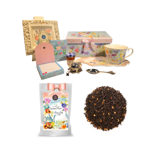 """Tea and Toast Gift Set -Wildflower: Enjoy your morning breakfast or afternoon tea and snack on this pretty set. A pleasant way to create a moment of indulgence. Sip on Conrcopia's specialty loose leaf tea and cuddle up with a good book, sounds inviting to whisk your cares away. Meant for everyday use. Comes in its own matching print gift box with matching satin ribbon. Great Gift Idea: New Mommy, Birthday, get well, thank you.  Gift Set Includes:  4.2"""" x 9"""" tray, Porcelain Teacup: Soft white background with a wildflower floral print, dishwasher safe 1 oz of Decafinated Loose-Leaf Cornucopia Tea. 7T6374 Decaffeinated Spiced Peach combines the essence of sun-ripened peaches with aromatic spices and a robust base of decaffeinated black tea. Conrucopia Teas come in resealable pouches with decorative tea labels as shown in the image, along with a recipe and brewing guide. 1 oz Bonne Maman honey, Embossed Purse Pad Each, pad is 3 inches x 4 inches and has 100 coordinating patterned pages and a magnetic closure, Teapot design Tea spoon, Tea Egg stainless steal Tea Filter with drip catcher by Cha Cult (Germany)  Teas and Teaware are shipped together.If purchasing as a gift your personal message is included on the pamphlet."""