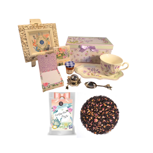 "Tea and Toast Gift Set -Lavender Rose:  Enjoy your morning breakfast or afternoon tea and snack on this pretty set.  A pleasant way to create a moment of indulgence.  Sip on Conrcopia's specialty loose leaf tea and cuddle up with a good book, sounds inviting to whisk your cares away. Meant for everyday use.  Comes in its own matching print gift box with matching satin ribbon. Great Gift Idea: New Mommy, Birthday, get well, thank you.    Gift Set Includes:  4.2"" x 9""  tray, Porcelain Teacup: Soft white background with a lavender and rose floral print, dishwasher safe  1 oz of Decafinated Loose-Leaf Cornucopia Tea. 7T6531 Earl Grey Rose combines our full-bodied organic black tea with fragrant rose petals. Conrucopia Teas come in resealable pouches with decorative tea labels as shown in the image, along with a recipe and brewing guide.  1 oz Bonne Maman honey, Embossed Purse Pad Each, pad is 3 inches x 4 inches and has 100 coordinating patterned pages and a magnetic closure, Teapot design Tea spoon, Tea Egg stainless steal Tea Filter with drip catcher by Cha Cult (Germany)   Teas and Teaware are shipped together. If purchasing as a gift your personal message is included on the pamphlet."