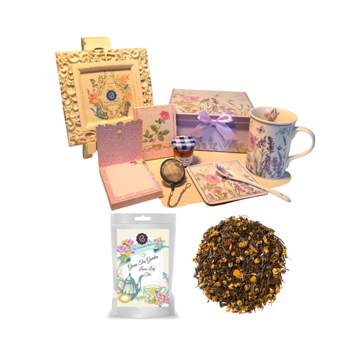 """TTea for Me Gift Set- Lavender Rose will brighten anyone's day in its own matching print gift box with matching satin ribbon. A decorative tassel on the handle adds a lovely finishing touch. The matching coaster is perfect for any spot you leave your cup and the porcelian teaspoon makes tea time all the more special, small tea ball, Conrucopia's Loose Leaf Tea, Bonne Maman Honey and stationary Purse Memo Pad complete this gift set. Gifting Idea: birthday gift, bridal shower, get well, office gift, or thank you.  Gift Includes:  4.9"""" Porcelain Mug in gift box, matching Coaster, Teaspoon,Soft white background with a lavender floral print, dishwasher safe. 1 oz of Loose-Leaf Cornucopia Tea 7T6414 Green Tea Garden: combines cinnamon and chamomile with a base of delicate green tea. Ingredients: Organic sencha, organic chamomile, organic cinnamon, organic hibiscus, natural flavor, organic calendula flowers, and organic corn flowers. Taste: carries an exotic flavor with floral undertones and a cinnamon spice finish. Cornucopia Teas come in resealable pouches with decorative tea labels as shown in the image, along with a recipe and brewing guide. (1) Cha Cult Tea Ball, small (Germany) for loose leaf tea, 1 oz Bonne Maman honey, (1) Embossed Purse Pad Each, pad is 3 inches x 4 inches and has 100 coordinating patterned pages and a magnetic closure."""