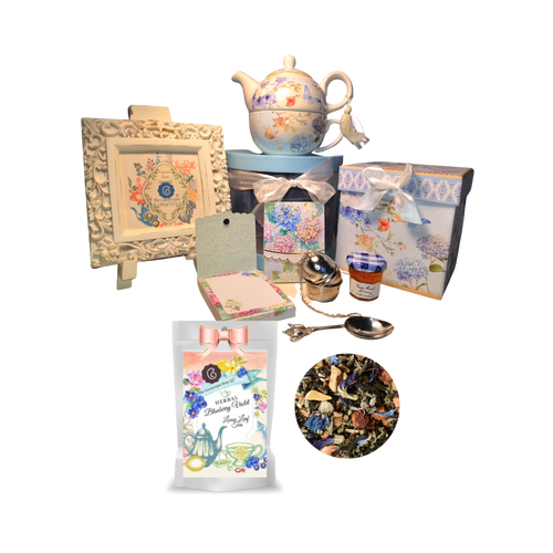 """Tea for One Gift Set-Blue Butterfly will brighten anyone's day with this beautiful tea for one gift set in its own matching print gift box with matching satin ribbon. A decorative tassel on the handle adds a lovely finishing touch. Cornucopia's Loose-Leaf Tea, 1 oz honey, Tea Filter, embossed stationary purse pad in a coordinated colors and pattern. Gifting Idea: birthday gift, bridal shower, get well, thank you or treat yourself. Holds enough for a refill without leaving your comfy spot, desk, or sip at beside for an evening nightcap.   Gift Set Includes: •5.8"""" Tea for One Set in gift box, stacked teapot and oversized teacup, soft white background with a blue butterfly floral print, dishwasher safe. •1 oz of Loose-Leaf Cornucopia Tea. 8T21219 Herbal Tea Blend Blueberry Violet: The delicate violet nuances accompanied by fruity blueberries offer a most convincing flavor. We are still searching for the answer to the mystery of the cup color, which shines emerald, green instead of butterfly pea lapis lazuli blue  oCornucopia Teas come in resealable pouches with decorative tea labels as shown in the image, along with a brewing guide. •1 oz Bonne Maman honey, •Embossed Purse Pad.  Each pad is 3 inches x 4 inches and has 100 coordinating patterned pages and a magnetic closure •Teapot design tea measuring spoon, holds enough for one cup of brewed tea •Tea Egg stainless steel Tea Filter with drip catcher by Cha Cult (Germany)  Gift comes in its decorative box as the gift basket container, shrink wrapped and decorative coordinating bow. Gift card comes with a 10% discount on their first purchase of tea, and your personal message. Card is tucked inside the shipping box with the gift."""
